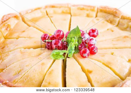 Sweet homemade apple cake with red currant decoration