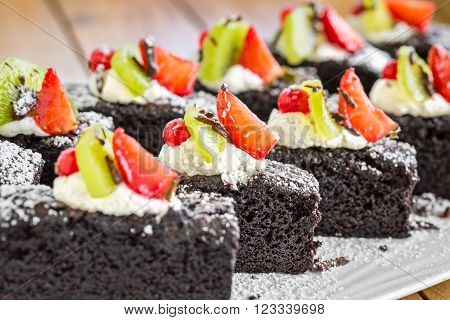 Cake chocolate brownies with strawberry and kiwi decoration