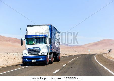 ATACAMA CHILE - NOVEMBER 14 2015: White semi-trailer truck Freightliner Columbia at the interurban freeway throught the Atacama Desert (Ruta del Desierto).