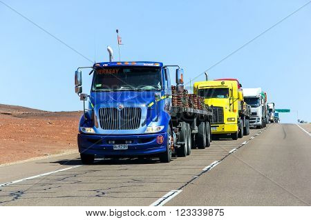 ATACAMA, CHILE - NOVEMBER 18, 2015: Blue semi-trailer truck International TranStar at the interurban freeway throught the Atacama Desert (Ruta del Desierto).