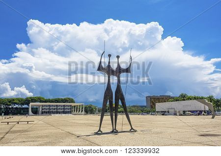 Brasilia, Brazil - November 18, 2015: View of Dois Candangos (Two Candangos) monument at Praca dos Tres Poderes (Three Powers Square) in Brasilia, capital of Brazil.