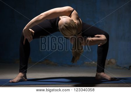 Beautiful Yoga Woman Standing In Twisting Sumo Squat Pose