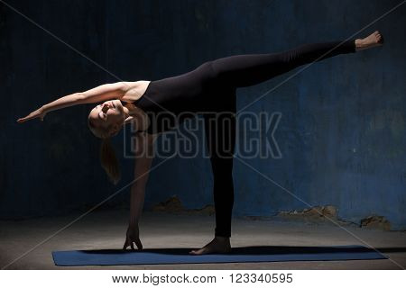 Beautiful Yoga Woman Doing Ardha Chandrasana Pose