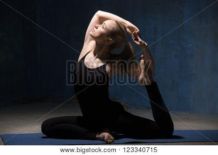 Beautiful Yoga Woman Sitting In Mermaid Pose