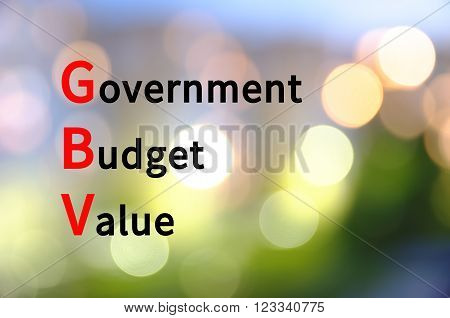 Acronym GBV as Government Budget Value. The blurred lights visible in the background.