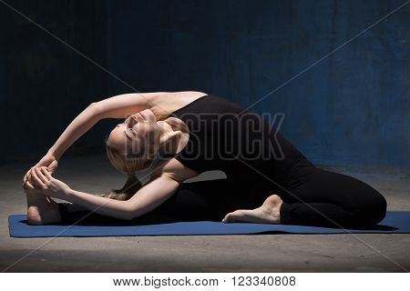 Beautiful Yoga Woman Sitting In Parivrrta Janu Sirsasana