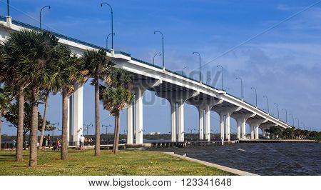 Jensen Beach, Florida, USA - December 25, 2015 : Jensen Beach Bridge Florida USA crossing Indian River on a cloudy and windy day