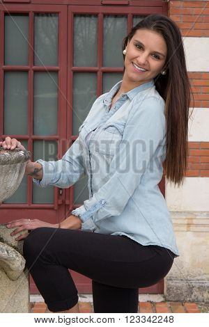 Pretty Multicultural Young Woman In An Outdoor Lifestyle Fashion Pose.
