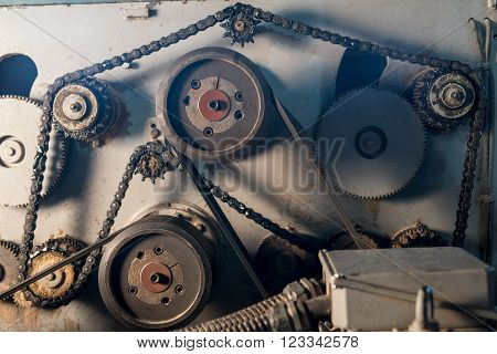 At sawmill. Image of gears and chain on machine