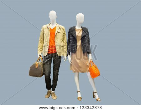Two mannequins male and female dressed in casual clothes. Isolated on grey background
