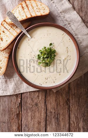 Du Barry French white soup on the table vertical top view