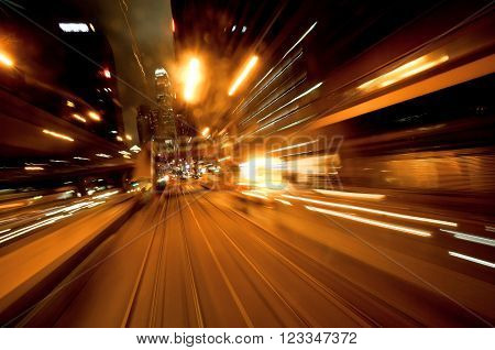 Cityscape with motion blurred reflections of a passing vehicle. Evening in the city of abstraction. ** Note: Visible grain at 100%, best at smaller sizes