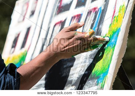 ATLANTA, GA - OCTOBER 17 2017:  An artist paints with his fingers in the Elevate Art festival at Woodruff Park in Atlanta GA on October 17 2015.