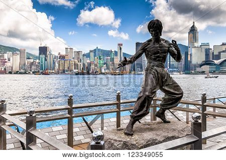 Hong Kong, China - August 22, 2011: The Bruce Lee memorial in Avenue of Stars. The memorial, a 2.5 metre bronze statue, was built on behalf of Bruce Lee, who died on 20 July 1973 at the age of 32.