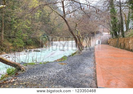 LOUTRA POZAR ARIADAEUS GREECE - March 15, 2016: River ?ermopotamos. Embankment of the river next to the thermal spring.
