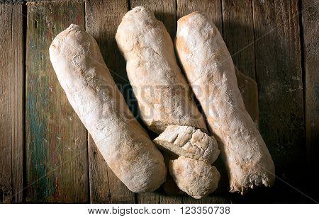 Crusty homemade Italian ciabatta bread on the wooden table