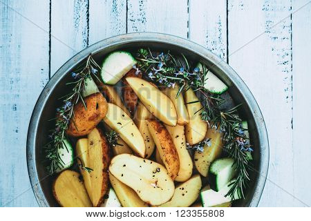 Raw potatoes. Preparation of potatoes with spices. Potatoes on wood.