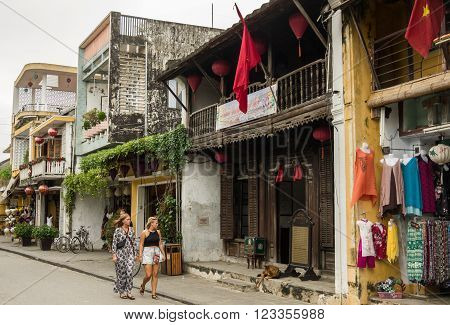 Hoi An, Vietnam -January 7, 2015: Tourists in the streets of Hoi An ancient town Vietnam