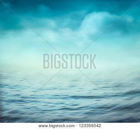Sea summer abstract background .Blue ocean and cloudscape and sunset in the back. Summer blur background.. Holiday background