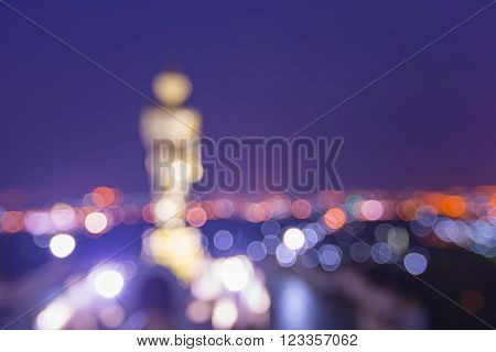 Blurred statue of buddha and city at Wat Phra That Kao Noi Temple Nan, THAILAND. ** Note: Visible grain at 100%, best at smaller sizes