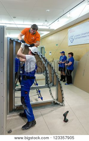 Tyumen, Russia - March 24, 2016: Open championship of professional skill among youth. World skills Russia Tyumen - 2016. Young workers performs task with gypsum cardboard