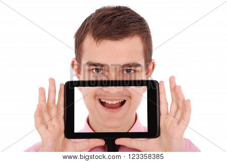 Boy in a pink shirt hold a tablet PC in front of his face isolated on white. Fun