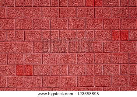 Red sand stone effect bricks / blocks wall background texture.