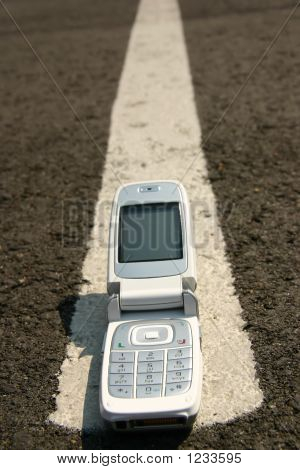 White Mobile Cell Phone On Road
