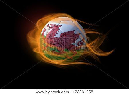 Soccer ball with the national flag of Wales on fire