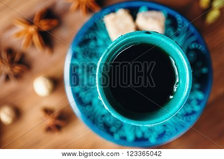 Hot Drink with Different Spices in Authentic Turkish Cups on Wooden Background. Selective Focus. View from Above.