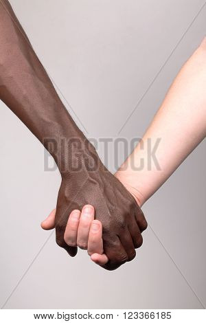 African man and white woman holding hands ** Note: Soft Focus at 100%, best at smaller sizes