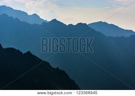 Mountains in the evening, dark mountainside with the evening light
