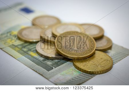 Turkish lira coin on euro coins and paper ** Note: Shallow depth of field