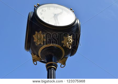 decorative accents on the bottom of a large clock.