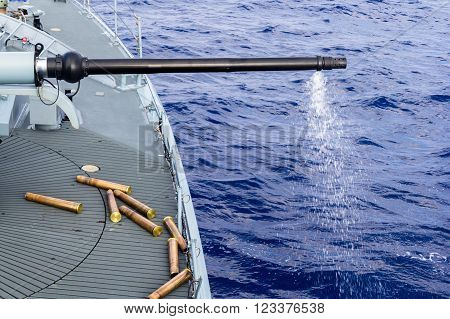 a fired cannon from a warship in sea