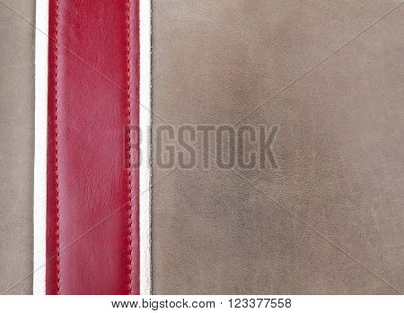 Grey and red leather stitched with copy space
