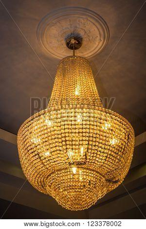 Old vintage chandelier with gold crystal lights