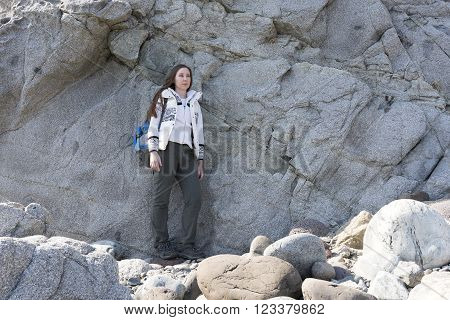 girl on the background of large stones on a halt
