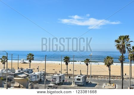 HUNTINGTON BEACH, CA - MARCH 25, 2015: Huntington Beach coastline and RV parking Lot seen from the Pacific City Development.