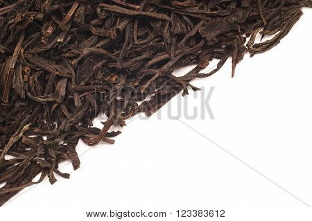Black leaf tea on the half of the frame. Photographed close-up.