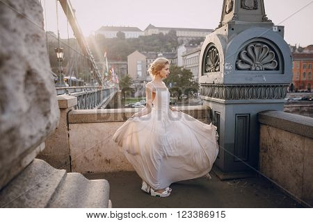 gorgeous wedding couple walking in the old city of Budapest