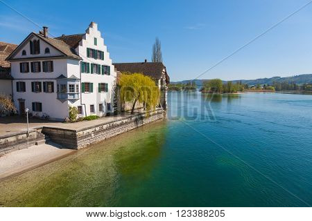 Lake view of Stein am Rhein Switzerland on a bright sunny day with crystal clear water and deep blue sky
