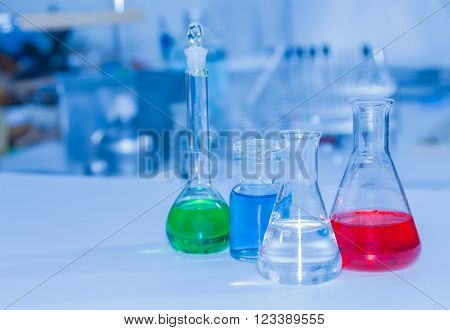 Laboratory glassware containing chemical liquid, science research. ** Note: Soft Focus at 100%, best at smaller sizes