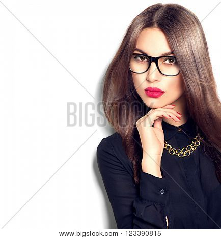 Beauty sexy fashion model girl portrait wearing glasses, isolated on white background. Beautiful young brunette woman with trendy accessories posing in studio