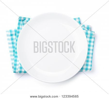 Empty plate over kitchen towel. Top view. Isolated on white background