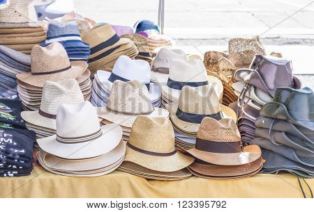 All kinds of hats for men on sale in a stand of a local market