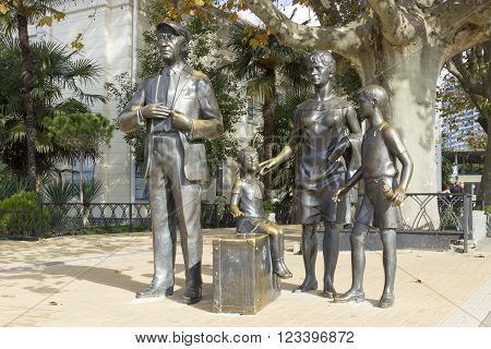 SOCHI, RUSSIA - November 06, 2015: The monument Mother, the father, two children from them the girl sits on a traveling bag waiting for a trip. The marina, Sochi, Russia is established