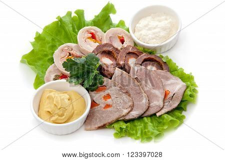 Cutting meat rolls on lettuce leaf with parsley and sauces: mustard and horseradish Isolated on white background