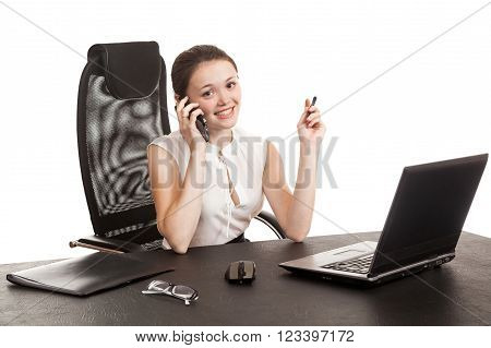 The Business Woman Sits At Office Table