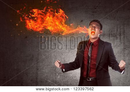 Young Asian Businessman In Anger Burning In Flame